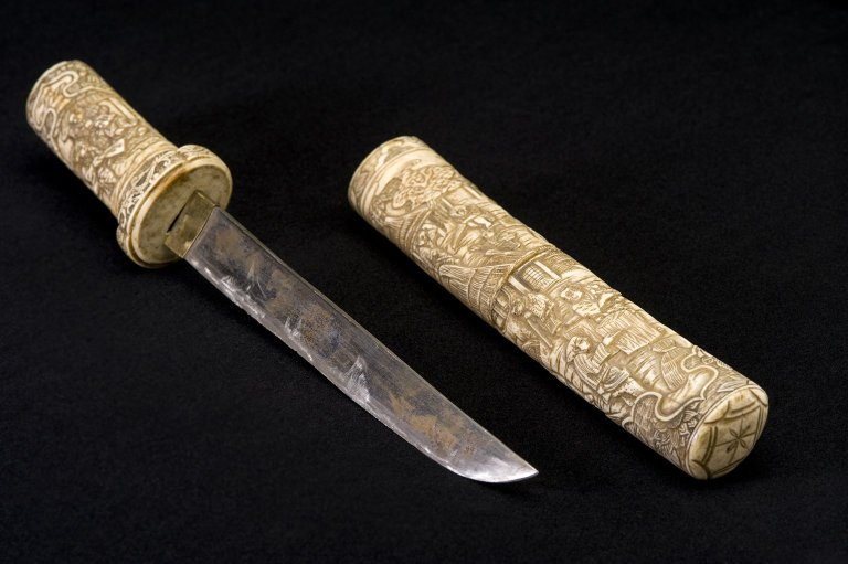 Short sword and scabbard.