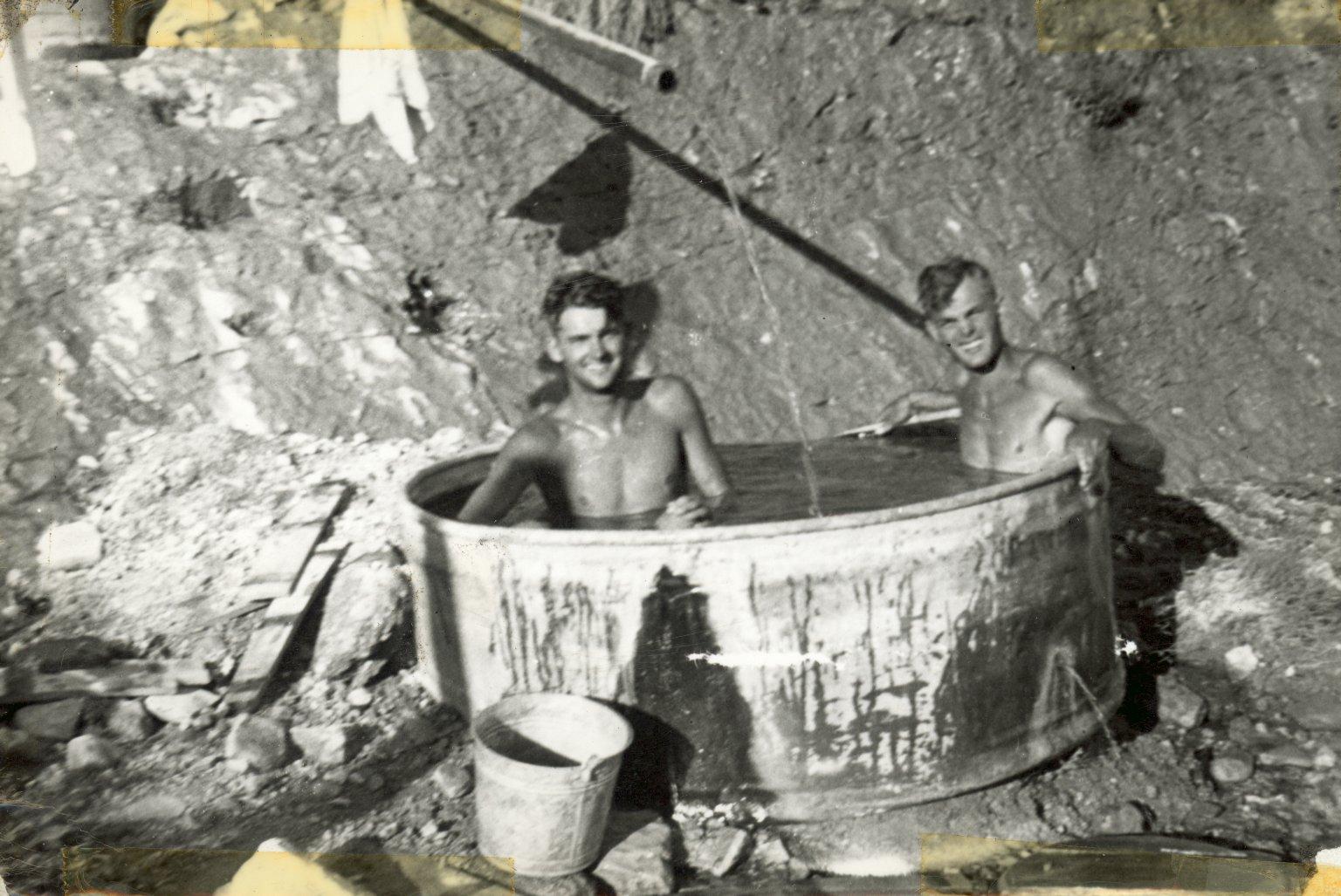 Crew bathing in washtub