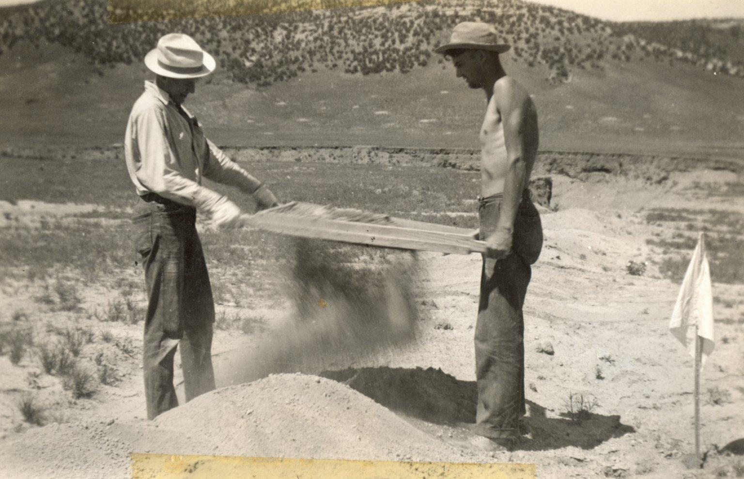 Sifting dirt at site