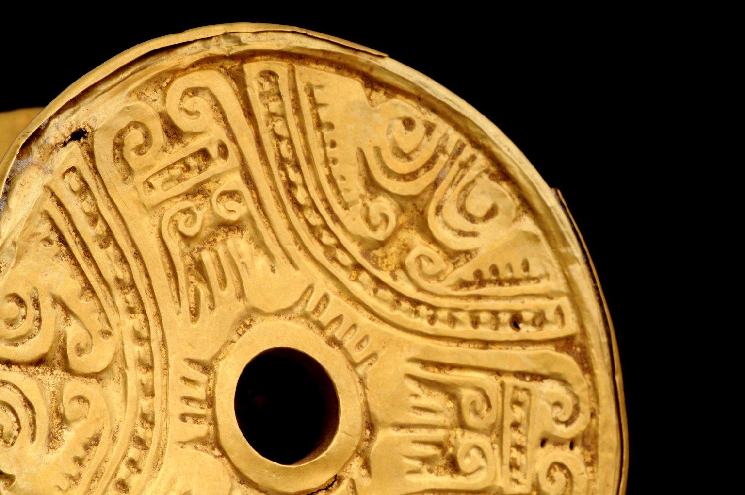 Gold ear spools, detail