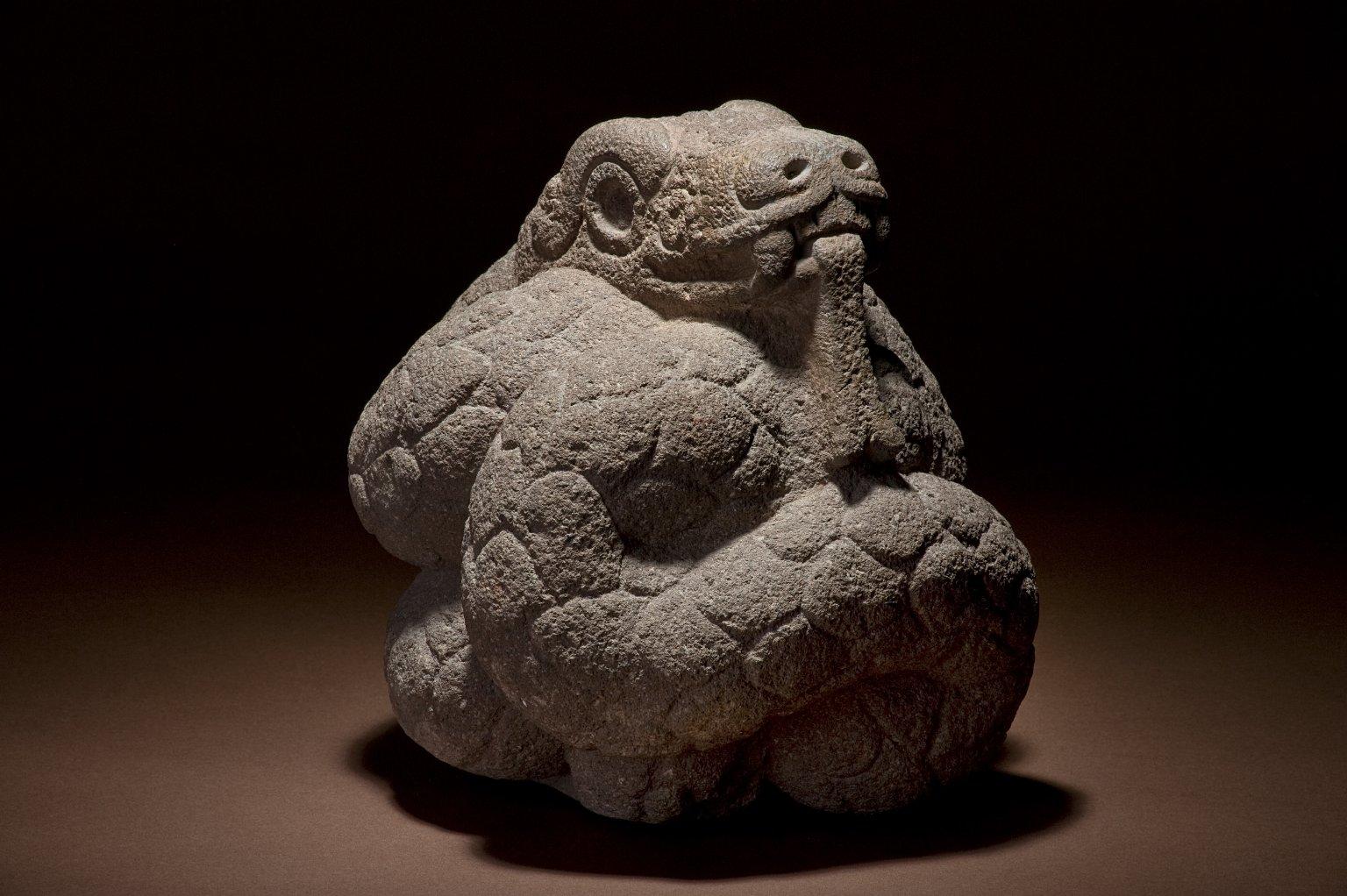 Carved basalt figure