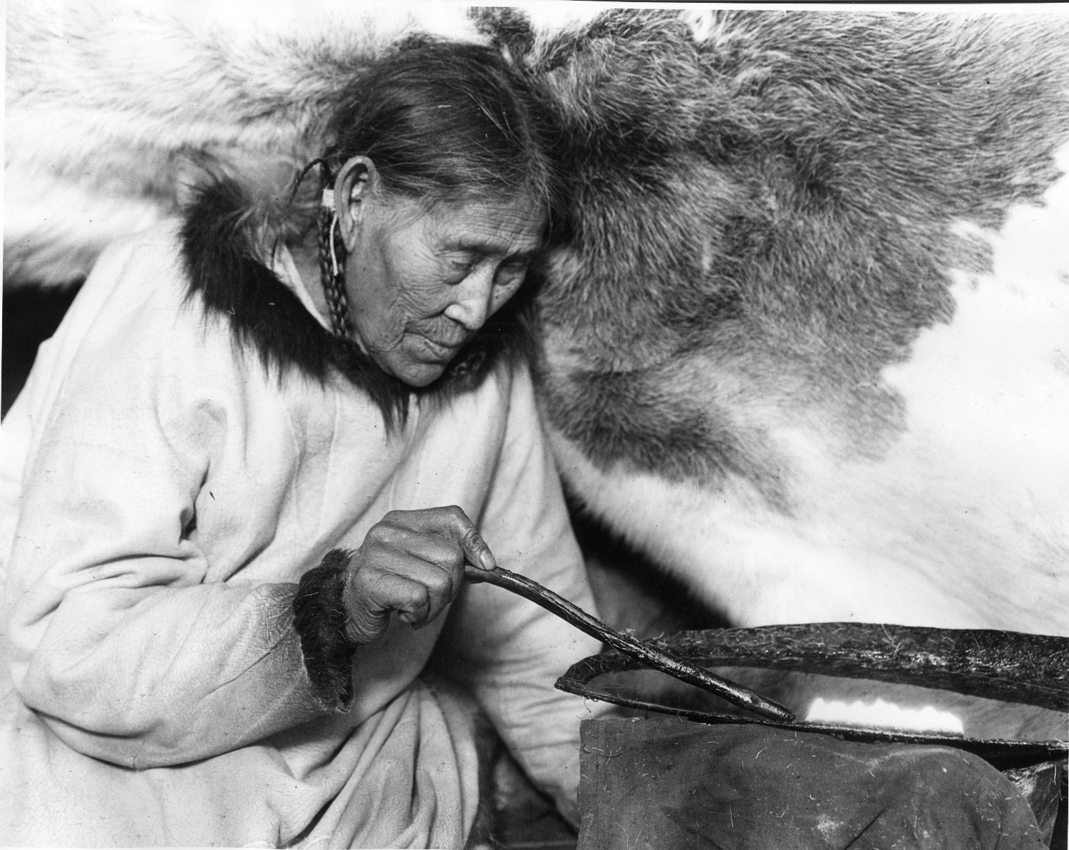 Native Woman with Seal Oil Lamp