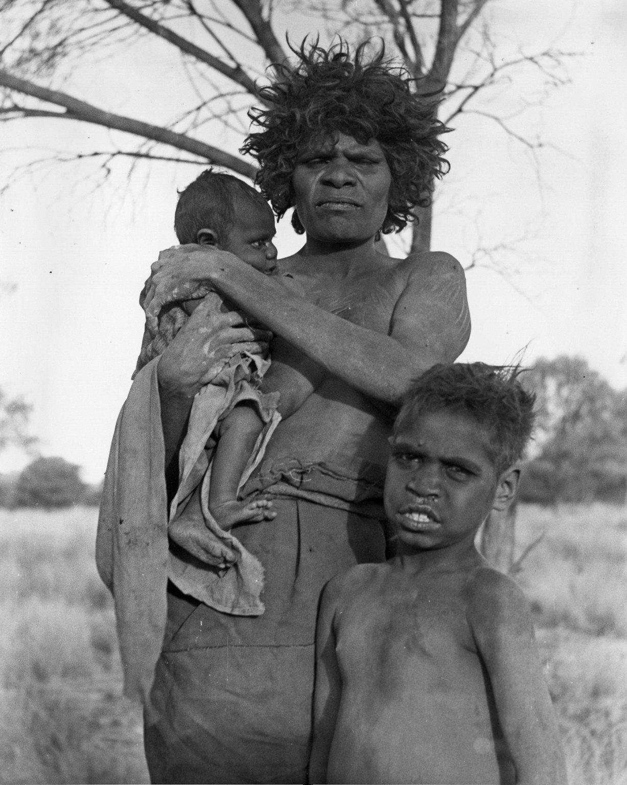 Aborigine woman and children