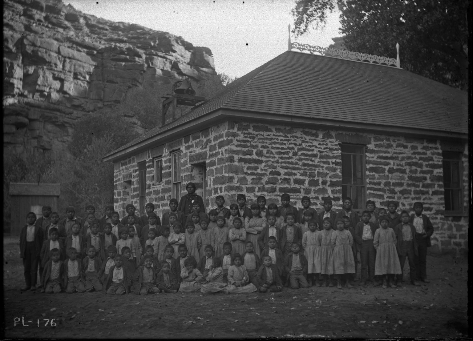 Scholars in Front of School Building