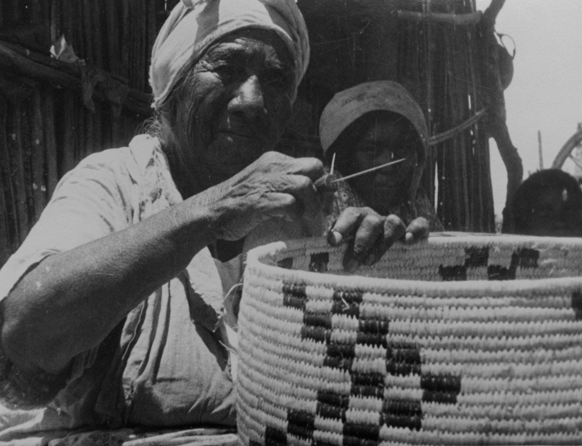 Chona Weaving a Basket