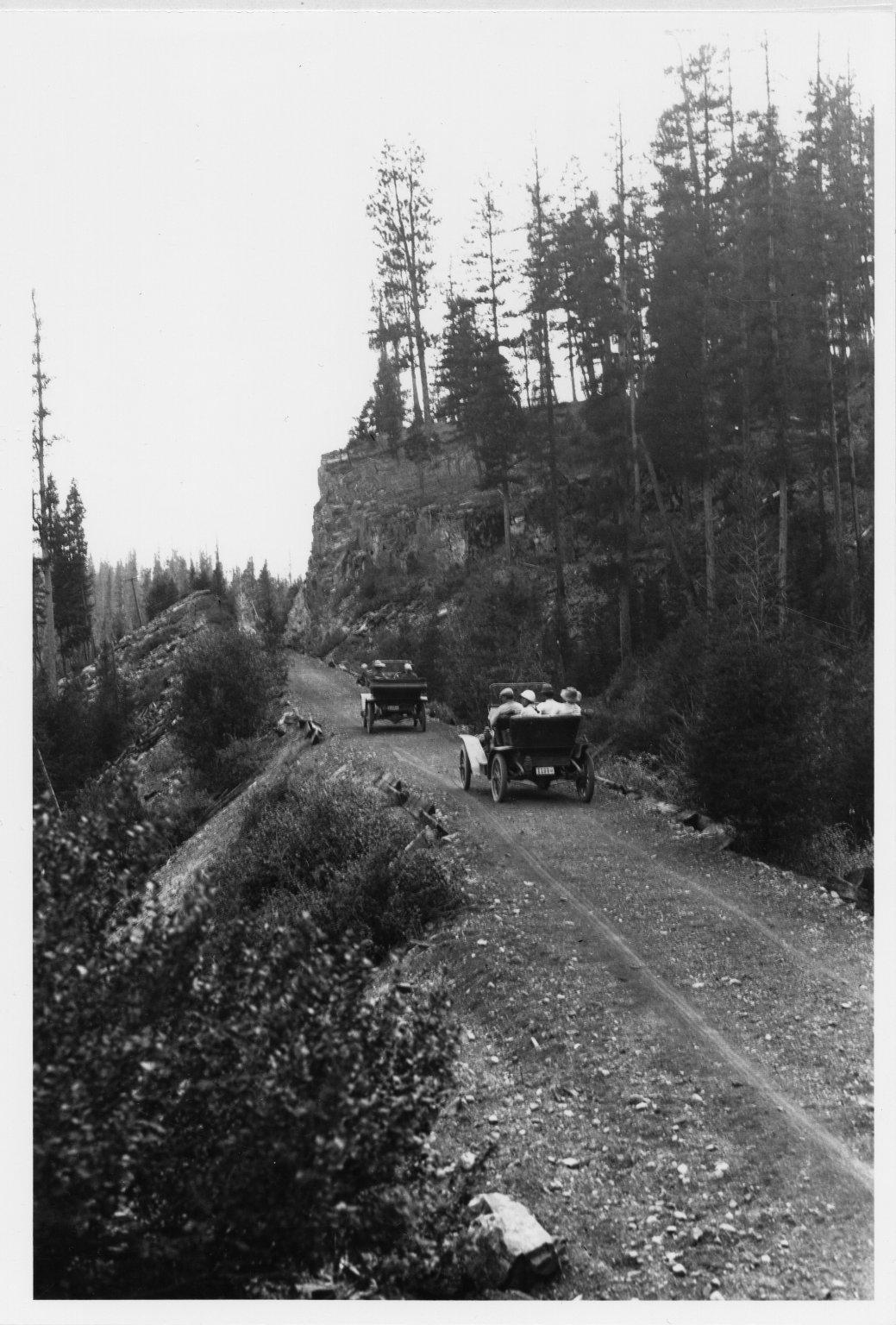 Automobiles on mountain road