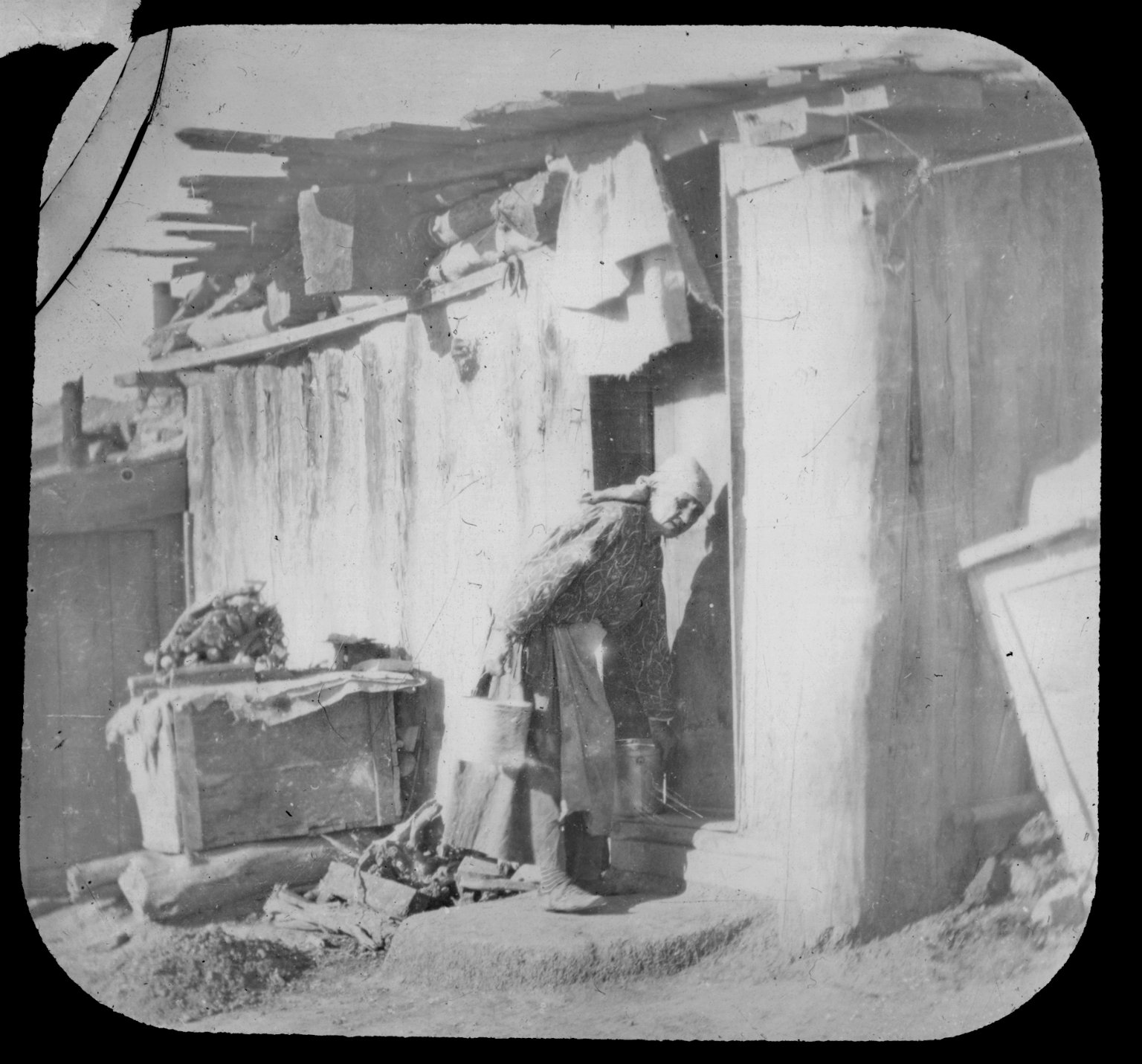 Native American woman with buckets