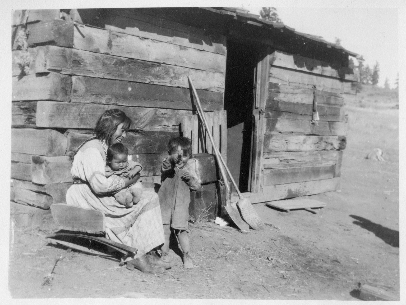 Jicarilla Apache woman with children