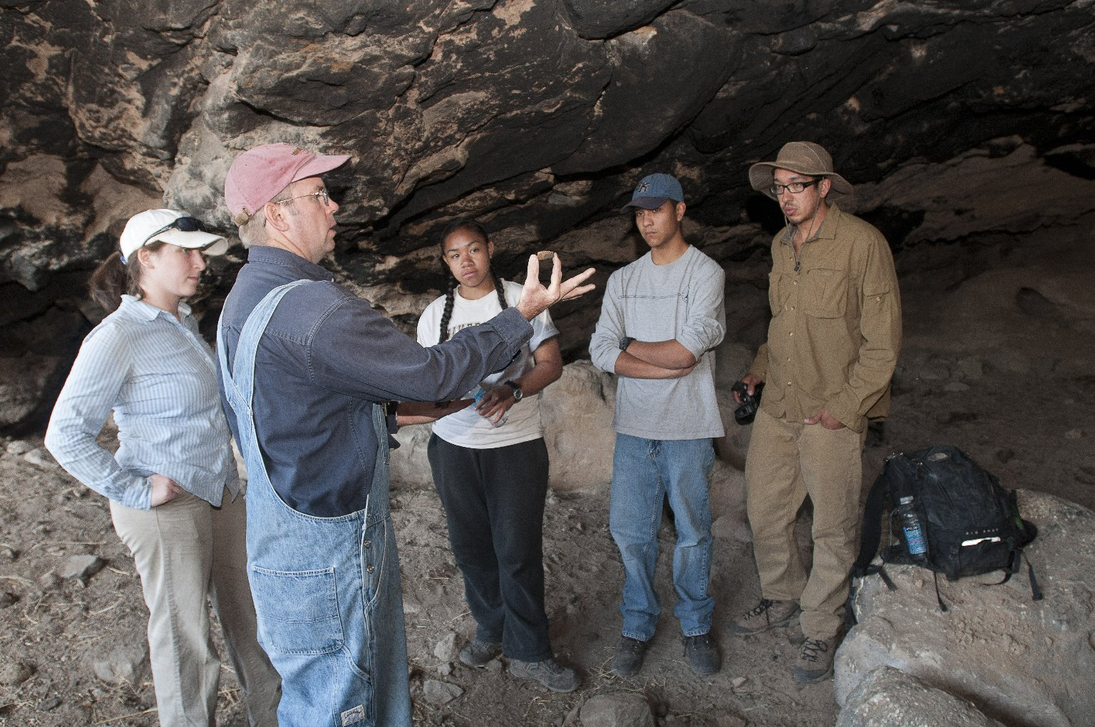 Dr. Steve Nash explains an object to the field team at the Hinkle Park Cliff Dwelling.