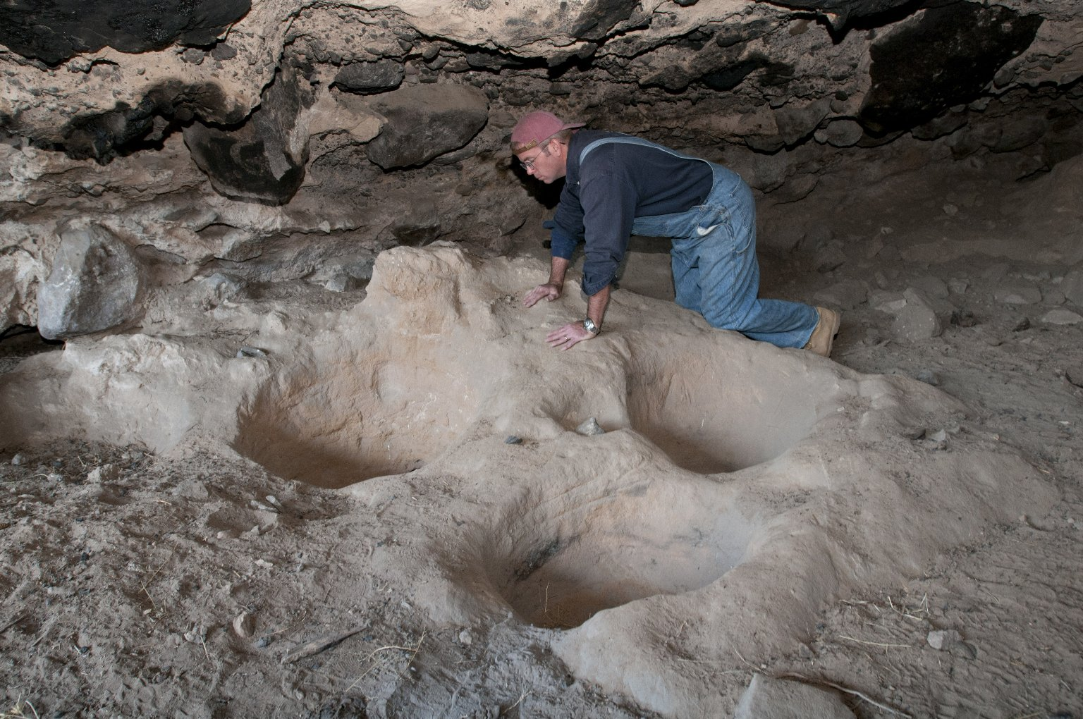 Dr. Steve Nash examines deep impressions at the Tularosa Cave.