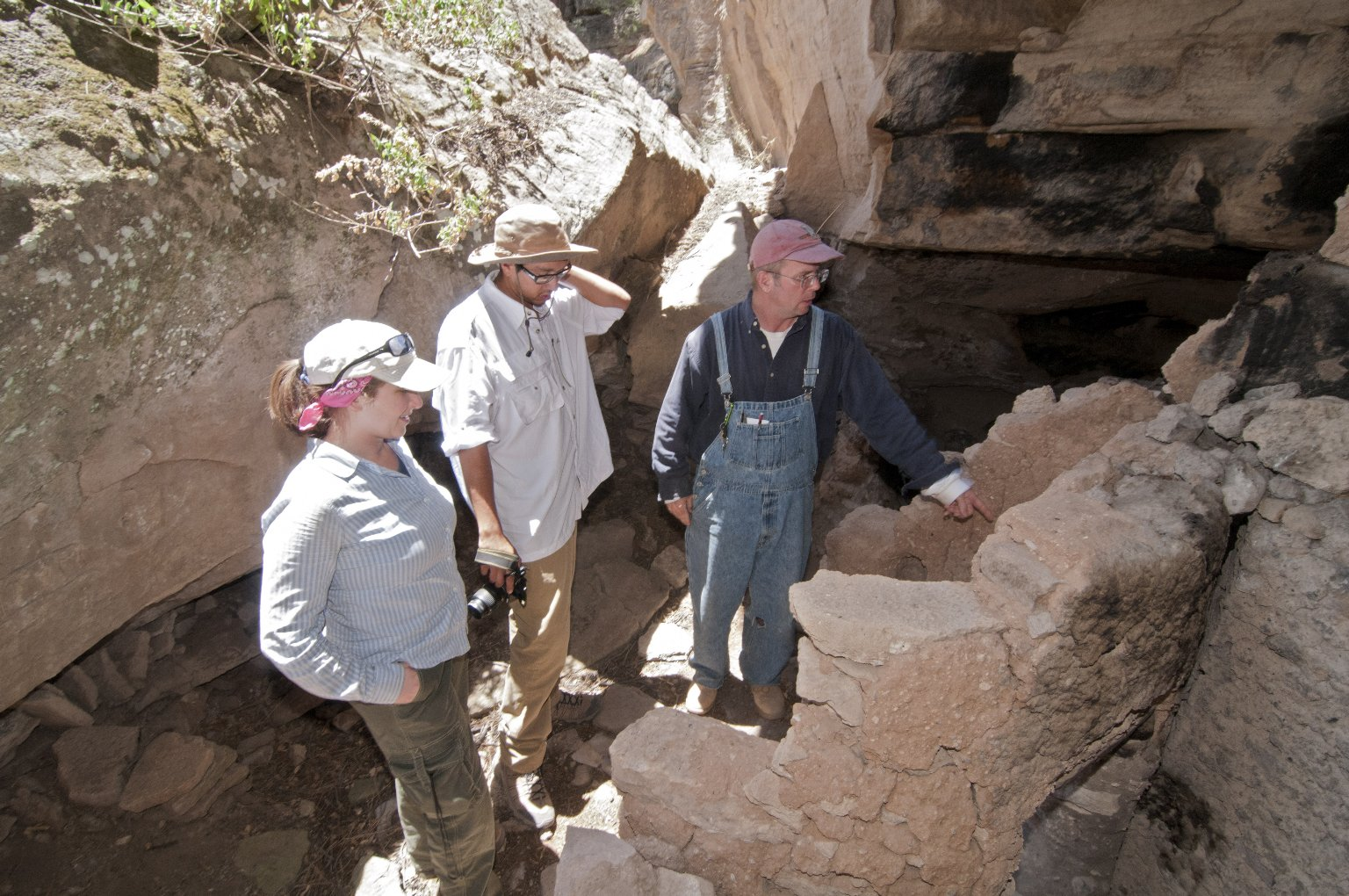 L-R: Hannah Chazin, PHD Student, Univ. of Chicago; Garrett Briggs; and Dr. Steve Nash at the Hinkle Park Cliff Dwelling.