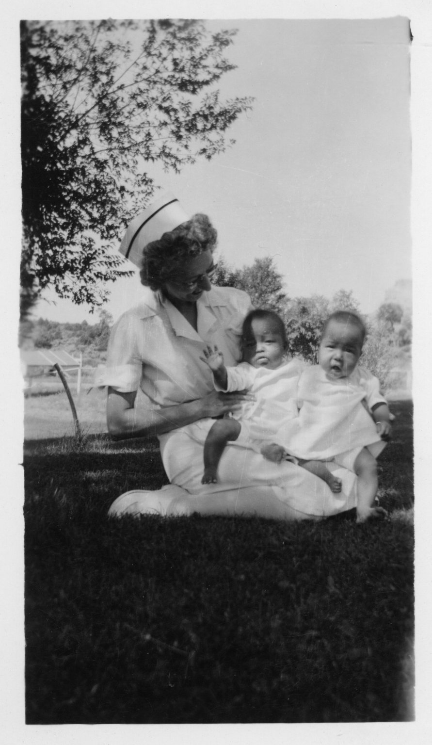 Nurse with twin girls