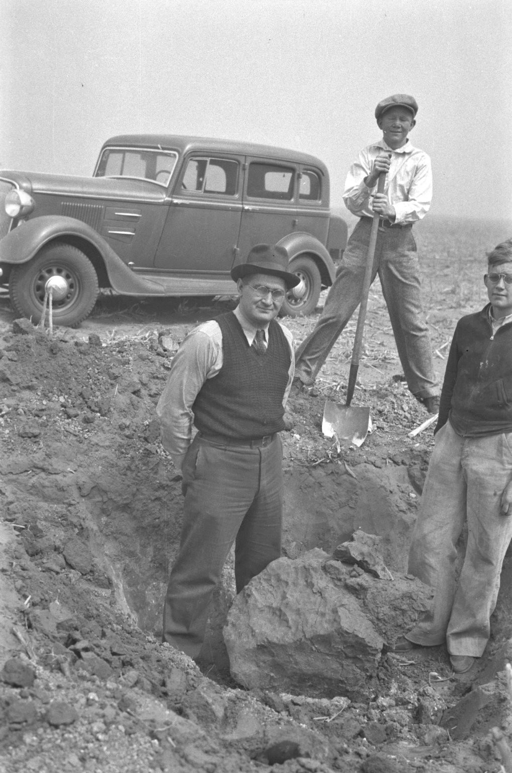 Mr. Hubbard, Bob Nininger and Bill with specimen in situ