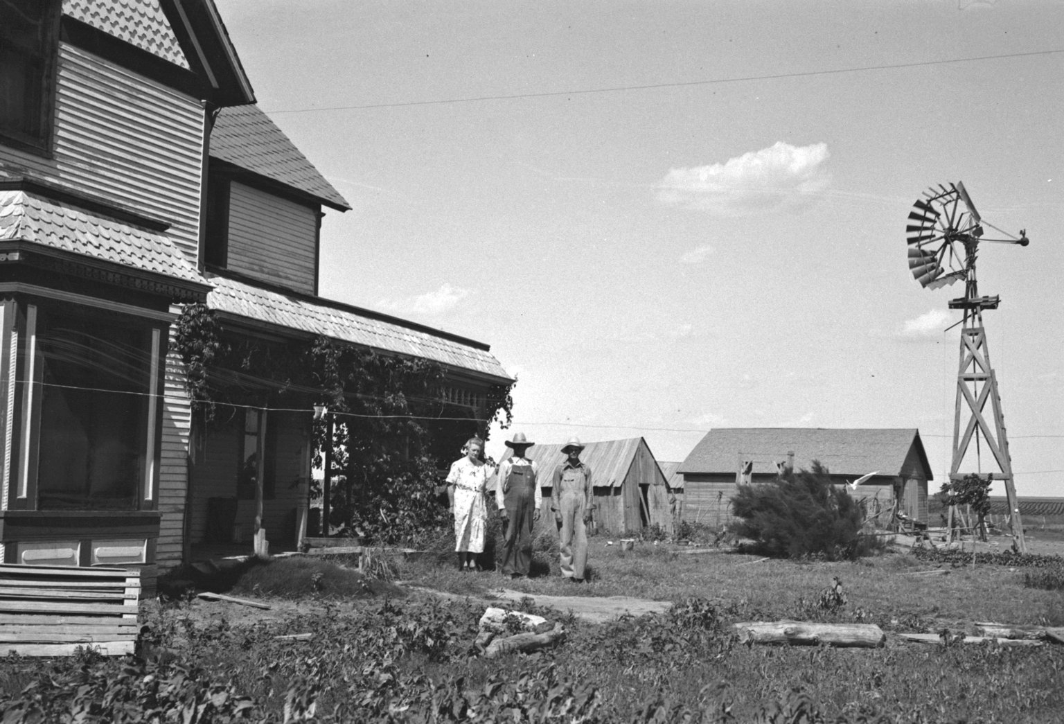 Mr. Hisey and family? in front of farm house