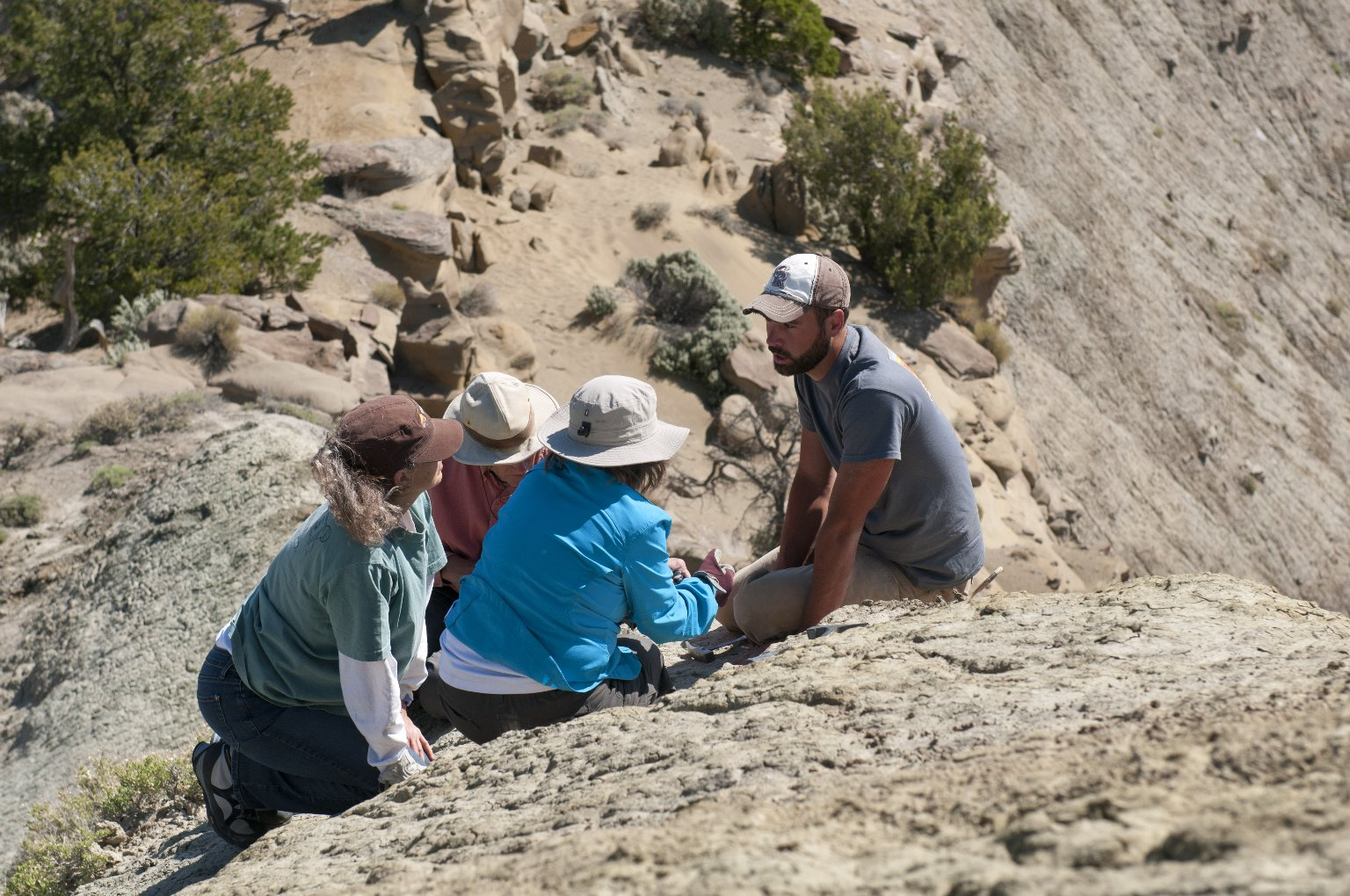 A DMNS Team discusses a potential dig site in the Kaiparowits Plateau.