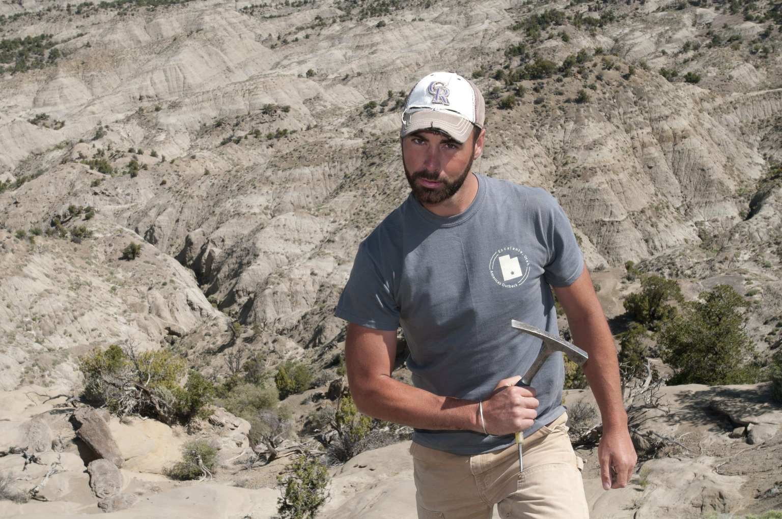 Dr. Joseph Sertich, DMNS Curator of Vertebrate Paleontology, is armed with a hammer and a chisel as he looks for specimens.