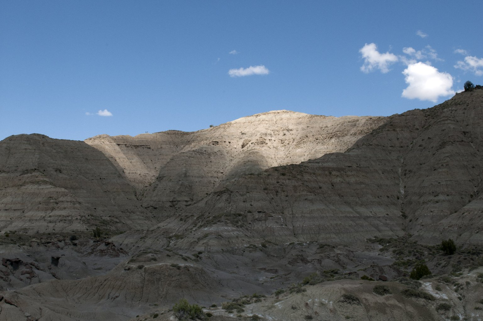 Clouds cause afternoon shadows on the Kaiparowits Plateau.