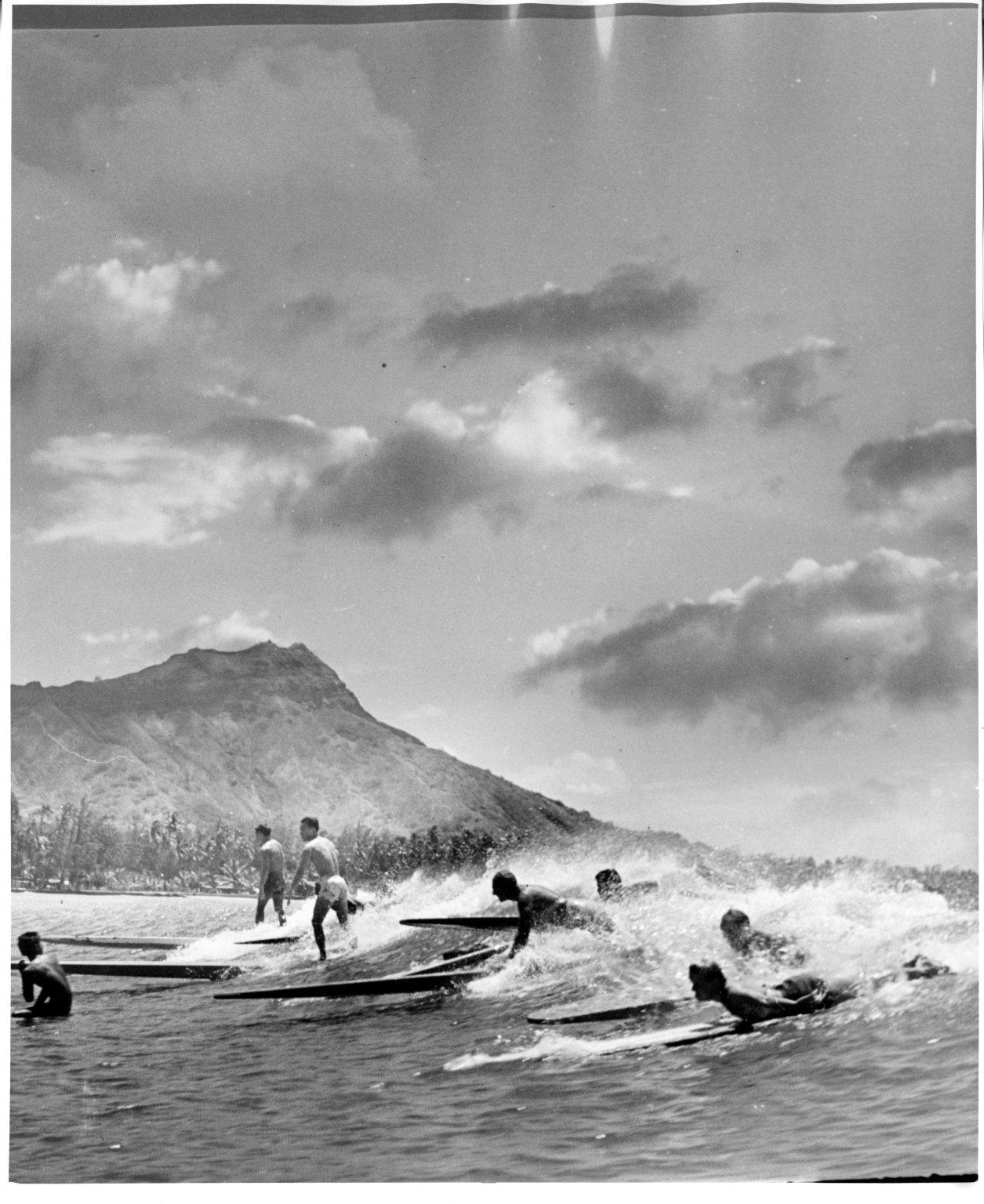 Surfers off Waikiki Beach