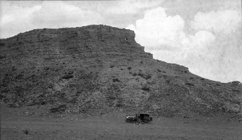 Unidentified man picnicing beside mesa