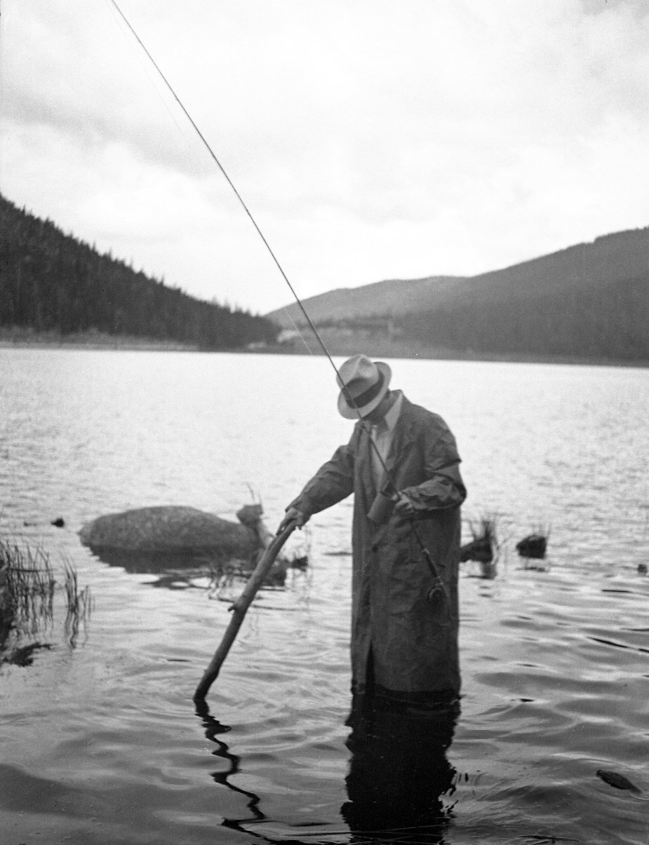 Robert Landberg fishing in a lake in the mountains.