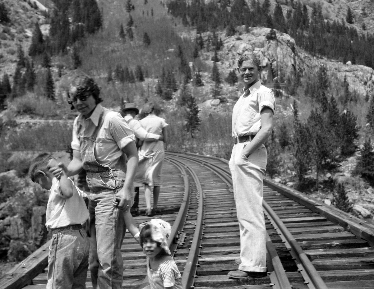 Robert Landberg and friends pose on a railroad trestle.
