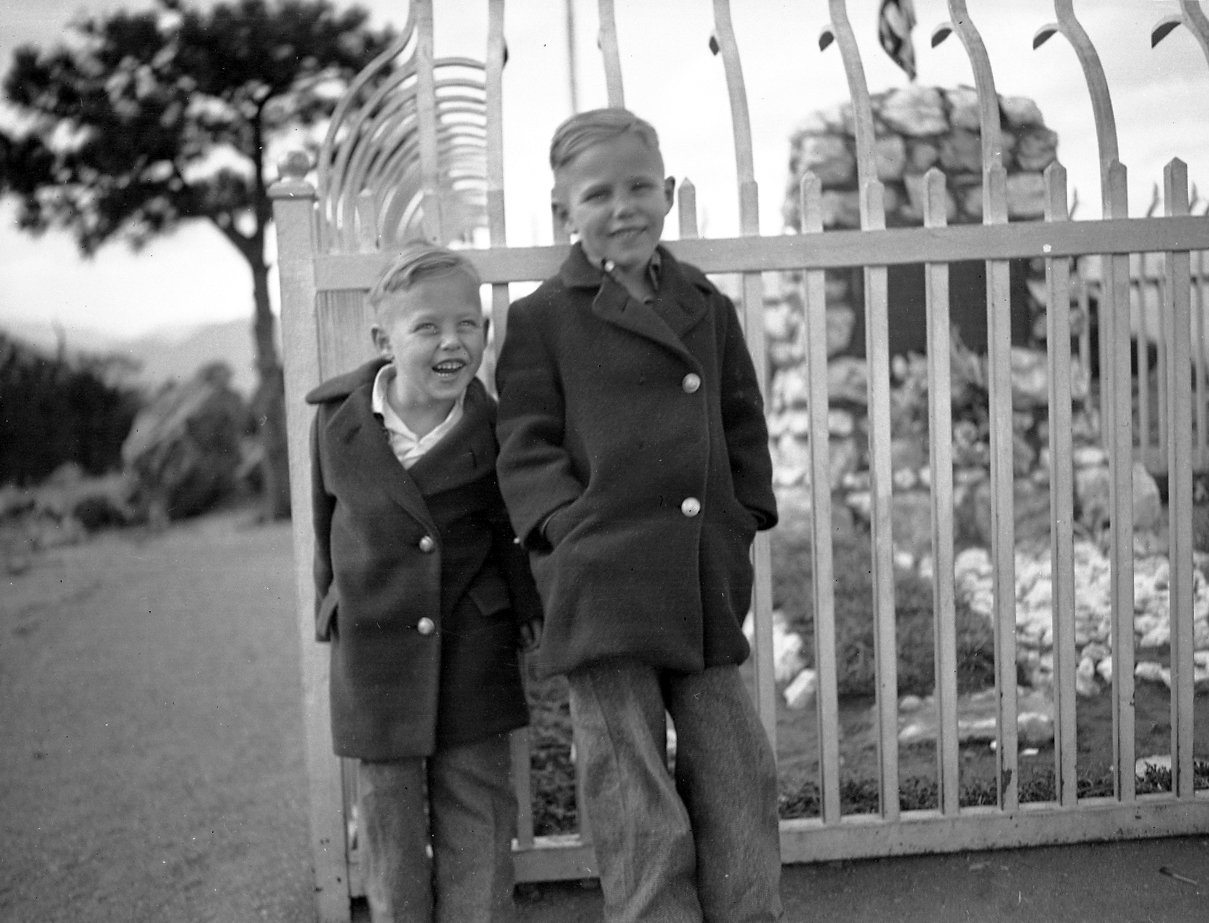 Two unidentified boys are pictured in front of Buffalo Bill's Grave on Lookout Mountain outside of Denver, Colorado.