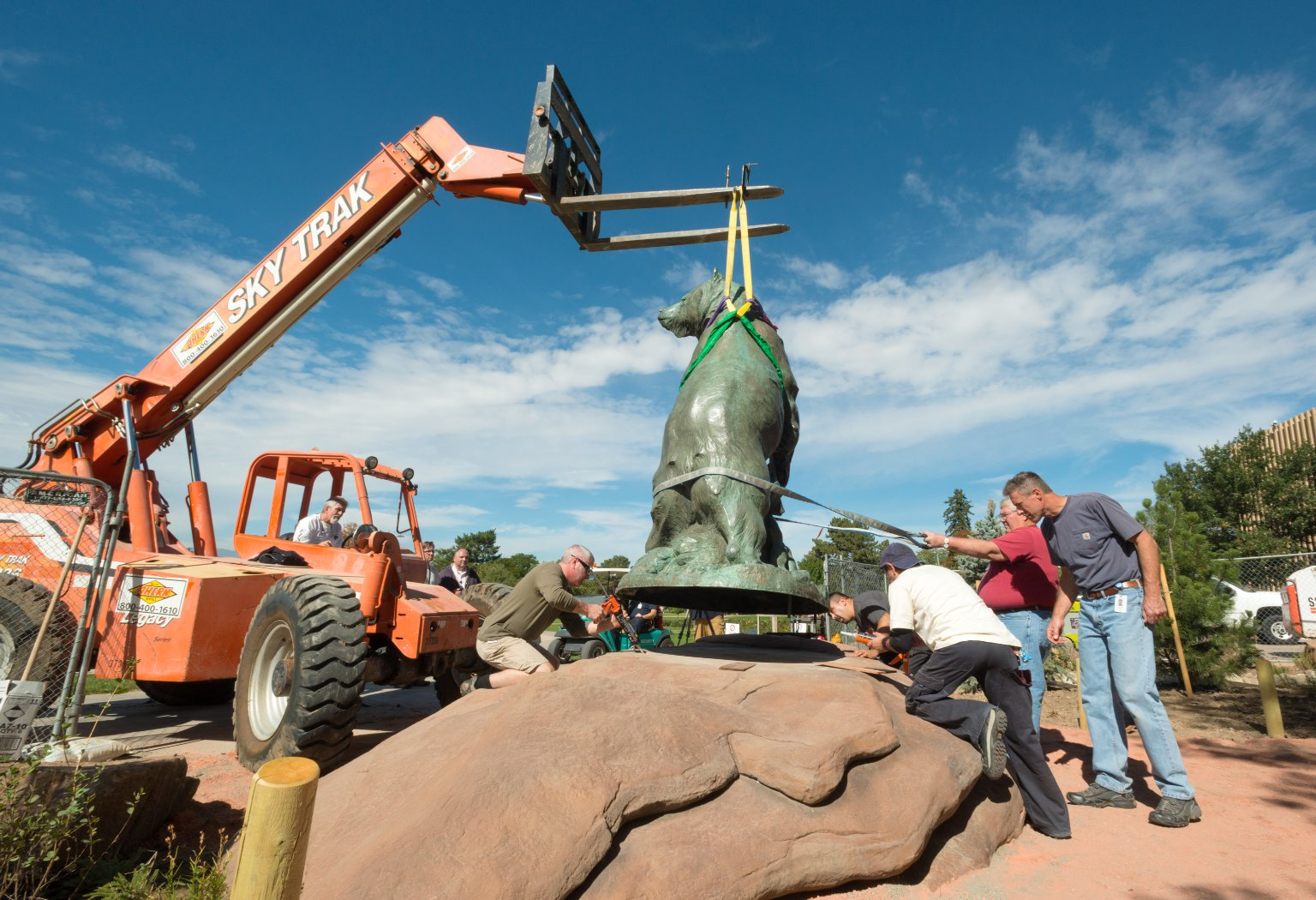 "Re-Installing Bronze Sculpture ""Grizzly's Last Stand"" to South West Corner, Exterior"