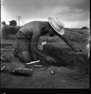 Excavation site worker with tools