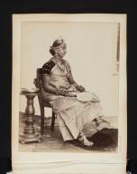 Seated woman with fan in Sri Lanka.