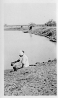 Unidentified Tohono O'odham Woman Gathering Water