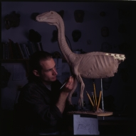 Gary Staab working on a model of a dinosaur