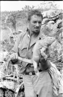 Carl Angermeyer with Iguana