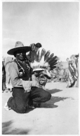 Portrait of a Ute Mountain Ute man with child