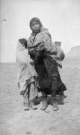 Portrait of a Ute boy and girl carrying a water jar