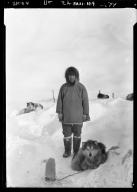 Eskimo man and sled dogs in Wainwright, Alaska