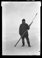 Jim Allen and a whaling dart gun in Wainwright, Alaska