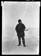 Jim Allen with whaling gun in Wainwright, Alaska