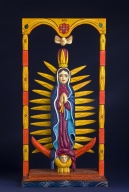 Colorful wood carving of the Virgin Mary.