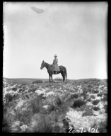Mrs. J. D Figgins on horseback
