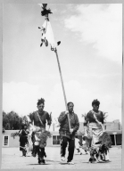 San Ildefonso Pueblo, Corn Dance. Adam Martinez (?), son of Maria Martinez, carrying clan banner