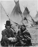 Rat Dog and family, Sioux, with native tipis