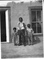 Pueblo man and boys