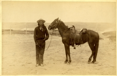 American Indian Man  with Saddled Horse