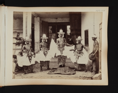 Five male dancers in costume from Sri Lanka.