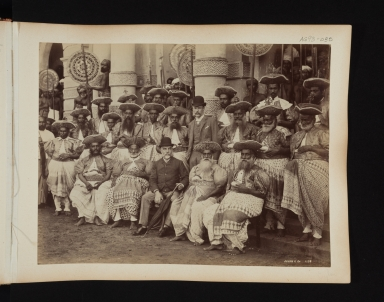Group portrait of 21 Ceylonese men and two European men.