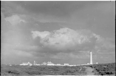 Lighthouse and nearby buildings on Cape Nelson