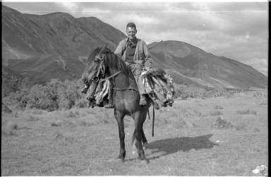 Dick Morris on horseback near Lewis Pass