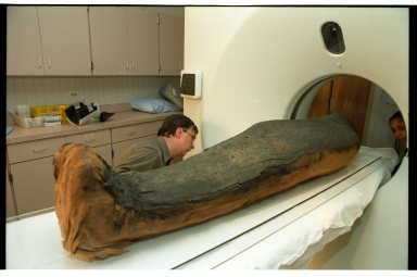 Preparing the mummy for a CT scan.