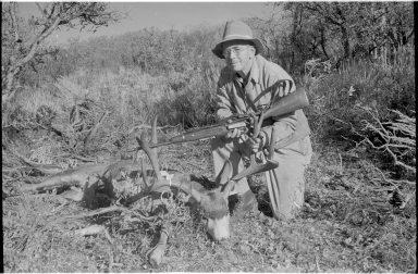 Alfred M. Bailey with a deer