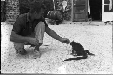 Carl Angermeyer with Marine Iguana